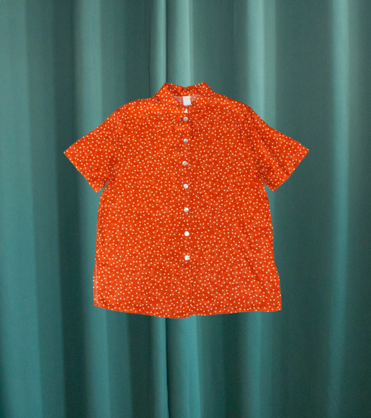 Vintage short-sleeved rust-colored shirt with white polka dots