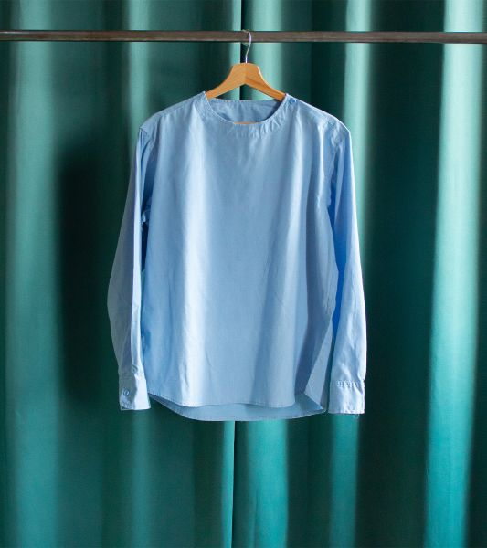 Pastel blue vintage military top with bias buttoned round neck