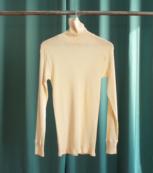 Off-white ribbed turtleneck sweater