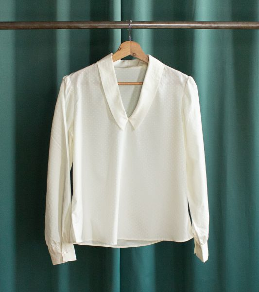 Vintage white blouse with embroidered pattern