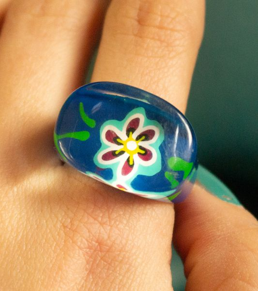 Blue vintage fantasy ring with a flower