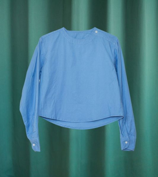 Vintage military top reworked into a sky blue round neck crop top