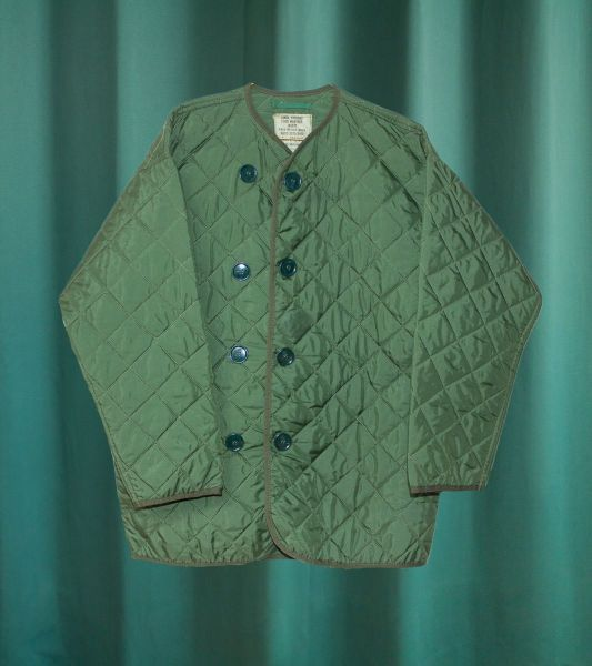 Olive green quilted vintage military liner jacket from the British Army
