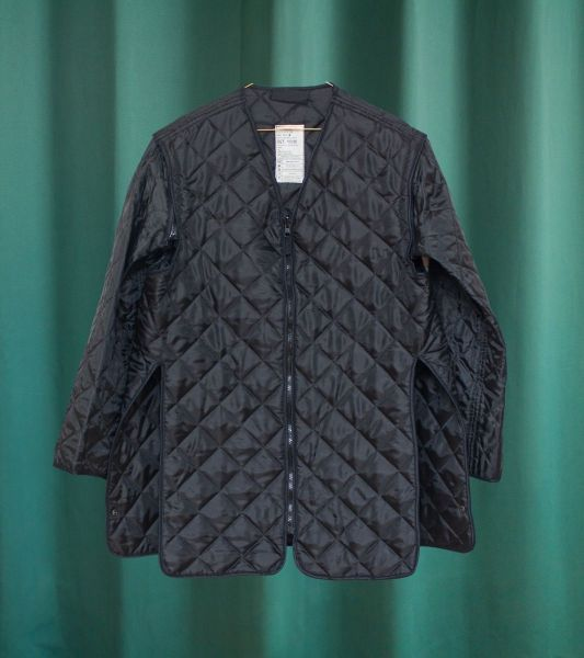 Black quilted liner jacket from the British army with removable sleeves